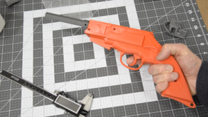 3D printed prop of Malcolm Reynolds' pistol from Firefly (Moses Brother Self-Defense Engine). Click to view full-size image.